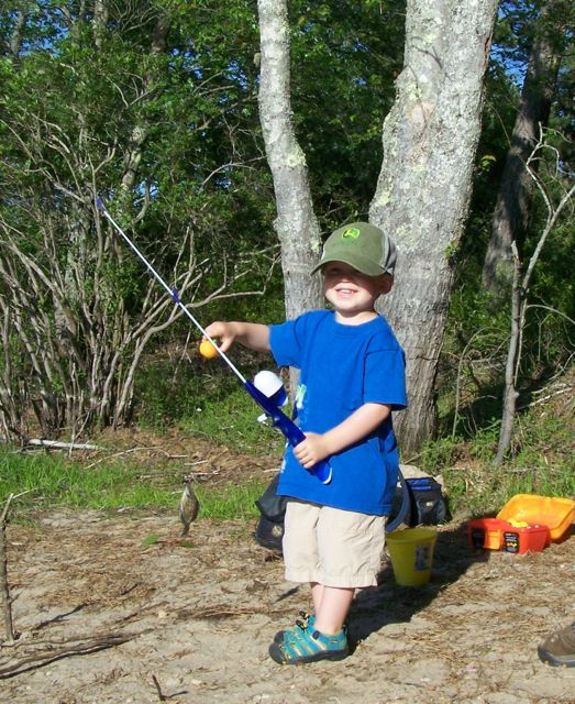 child with fishing gear at Fearing Pond