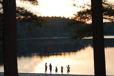 Family silhouetted on Fearing Pond campground