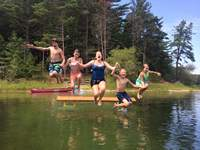 Kids jumping into pond in Myles Standish State Forest